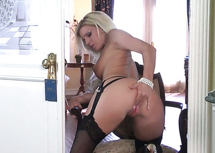Niki Young with gigantic breasts and shaved snatch gives a closeup of her bush as she masturbates with dildo