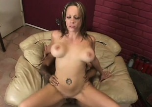 Stunning milf with big boobs has a hard schlong pounding her needy holes