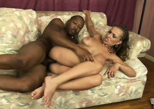 Ebony woman with terrific knockers gets corned by black fat cock
