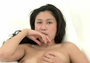 Alluring Oriental dreamboat Ming caresses her ideal shaven snatch