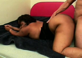 Chunky swarthy lady has a hung black dude satisfying her sexual desires