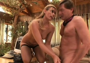 Blond milf in blackguardly stockings Darryl Hanah gives an awesome footjob