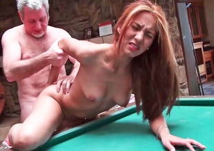Dark brown is having some hot sex on the pool table here
