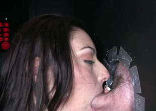 Sexy thing is getting a dick placed inside her mouth in a glory hole