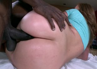 Dark brown is getting her ass penetrated by a black meat stick