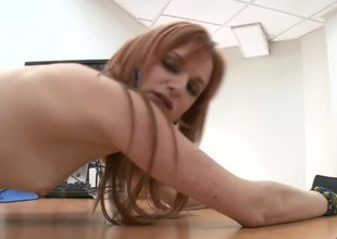 A redhead is showing us how good she is at handling a large dick