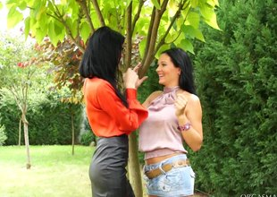 Two tanned lesbian babes having a sexy vibrator session not at home