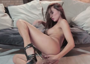 Fabulous and slender sweetie Michaela Isizzu gently pokes herself in the pussy