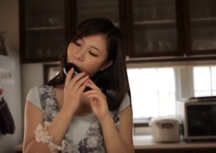Japanese rubs food on her moist pussy in the kitchen