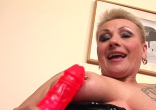 This horny mature slut really can't live without her toy