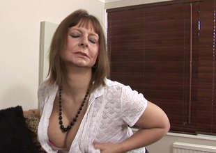 Large titted mama playing and getting horny