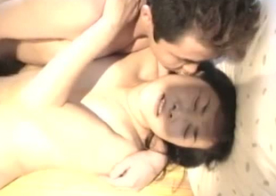 Wicked Japanese MILF is fucked bad in a missionary position