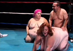 Chubby ladies play with a sex-toy and share a midget's dick in the ring