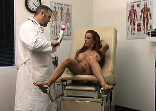 Appealing scarlet woman visits doctor for routine check up and shows her cunny
