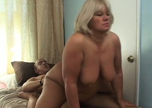 Chunky age-old blonde has a hung black stud fulfilling her raunchy needs