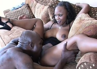 Darksome skinned pulchritude with big boobs takes a huge black dick in her a-hole