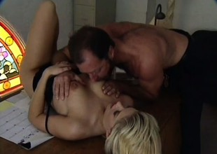 Blonde secretary with a fabulous body seduces her boss in the office