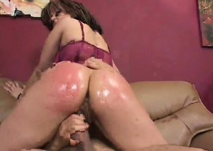 Ravishing whore with large boobs is oiled and pounded by vicious male