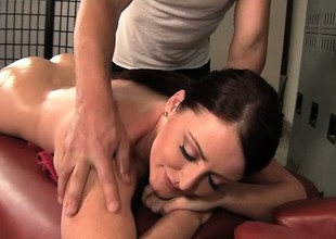 Curvy brunette Sophie Dee gets a relaxing rub down and a hard pounding