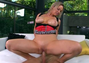 A milf porn star is on a cock, as she is given a sexy dick ride