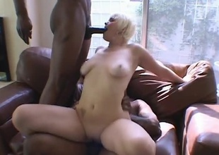Short haired blonde chick Claudia Downs loves to suck on big cocks, especially big black ones! When Mr.Marcus and Jean Claude show up, she's in Heaven as these two studs stuff her throat full of man meat. They flip ths chick over and start to drill her pussy
